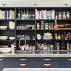 Part of The Mad House Tour, my open kitchen shelves. No they don't really get dusty because we are always using the things on them and moving things around. Shelves painted in @farrowandball Railings with leather handles from @superfrontdotcom image by Dan Lowe for @habitatuk and featured in @eshomesproperty #interiorsobsessed #interiorsinspiration #handmade #interiorblogger #interiordesign #mykitchen