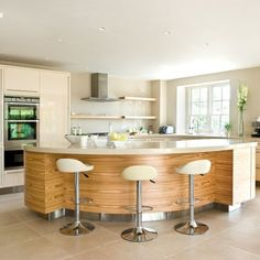Sleek and glossy breakfast bar | Take a tour around a sleek and glossy cream kitchen | housetohome.co.uk