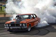 A supercharged 1971 XY GT HO Ford Falcon burning some rubber at the 2014 Rod Stock & Custom Bendigo. Australian Muscle Cars, Aussie Muscle Cars, American Muscle Cars, Car Ford, Ford Gt, Ford Falcon, Dashcam, Drag Cars, Performance Cars