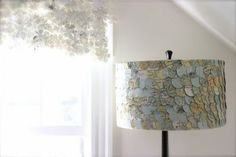 Making a lamp shade from old maps is a fantastic ideas.  Also envisioning old postcards...    eclectic lamp shades by Etsy