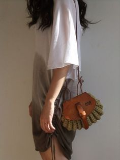 Thick leather and crochet beige cotton cord bag. Made in Brazil.