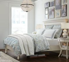 Jessie Organic Duvet Cover & Sham | Pottery Barn - I pinned this for the frame arrangement above the bed