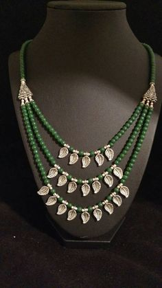 Check out this item in my Etsy shop https://www.etsy.com/listing/386172068/three-strand-green-onyx-beaded-necklace