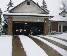 Heated driveway with four heated tire tracks