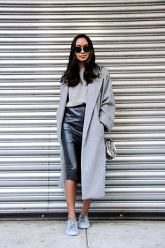 long grey coat, textured knit, leather skirt and grey sneakers #style #fashion