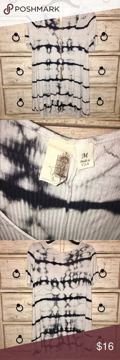 White & dark navy tye die, high low top A high low, tie dye top that looks good with jeans, leggings & shorts! Top has been worn about 3-4 times, and still has so much more wear to give! Can be dressed with jeans for casual wear, or a pair of leather leggings for a night out. Tops Tees - Short Sleeve