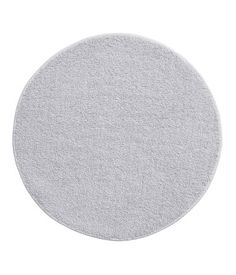 Bath mat in thick cotton terry with banded trim. Diameter 27 1/2 in.