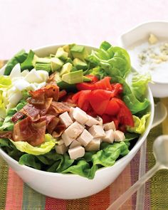 Lighter Cobb Salad - there is no mystery to this recipe, but the picture is so pretty I can't resist pinning it. We eat a variation of Cobb salad at least twice a week during the warmer months.