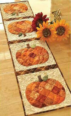 Patchwork Pumpkin Quilted Table Runner Pattern Get ready for autumn with this cute harvest table runner! Use your favorite orange scraps to complete this cute project. This sophisticated fall decoration Halloween Quilts, Table Runner And Placemats, Quilted Table Runners, Fall Table Runner, Halloween Table Runners, Thanksgiving Table Runner, Autumn Table, Quilted Table Runner Patterns, Autumn Harvest