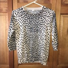 J.Crew leopard print sweater RePosh item and at *****lowest price******, never worn. I love this sweater but it's too tight for my liking. 100% Merino wool (dry clean only, fyi), tag says medium but to me it fits more like a small. Three quarter length sleeves, bottom of sweater hits right at the top of pants. J. Crew Sweaters Crew & Scoop Necks