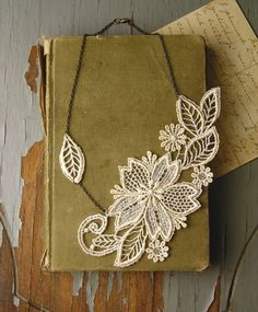 Lace bloom necklace offset by leaf. #lace #necklace
