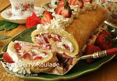 Strawberry Roulade....A fresh strawberry cake made into a classic jelly roll style roulade. This simple roulade is made with a basic sponge cake, and filled with luscious fresh strawberries, sweetened whipped cream, and strawberry jam. Serve the cake with just a sprinkling of powdered sugar on top, or decorate with extra whipped cream and fresh strawberries. Either way, it's delicious