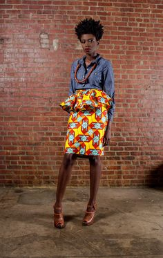 Bias cut fitted straight unlined skirt w/ peplum. 10 back vent slit. Invisible zipper and hook and eye closure.    FABRIC CONTENT: African Print