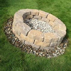 DIY fire pit!! $65 for surrounding blocks and $5 for river rocks!! Can't wait to try it out!