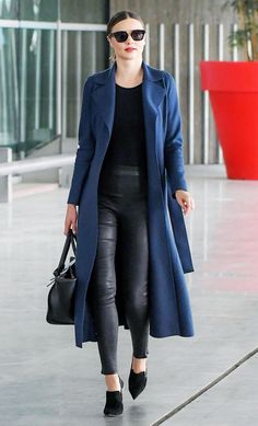 Miranda Kerr tosses a trench over her look and instantly looks polished.