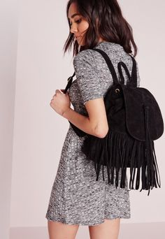 Gettin' fringey with it! This chic tassel trim backpack in always on trend black takes effortless styling to a whole new level. Take with you on that summer road trip or festival for boho vibes.