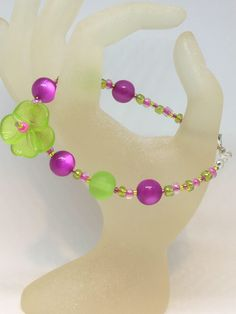 Excited to share the latest addition to my #etsy shop: Lime Green & pink Bead Pansy Flower Bracelet Handmade Bracelet-Gifts for women-Gifts for her-Ladies Jewellery-Ladies gifts £3.99 juliedeeleyjewellery.com