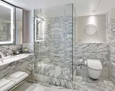 Marble bathroom at the London Mariott Park Lane, featuring TOTO Washlet WCs Arabescato Marble, Hyde Park London, Marble Suppliers, Shower Screen, Marriott Hotels, London Hotels, Luxury Accommodation, Wall Cladding, Marble Floor