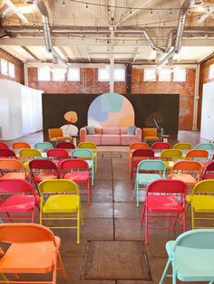 Bright and bold colorful folding chairs in a minimal, industrial event space - corporate event design Estilo Color Block, Outdoor Lounge, Corporate Event Design, Corporate Events Decor, Architecture Restaurant, Stage Design, Set Design, Event Styling, Event Decor