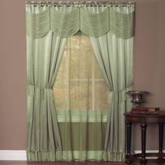 "Sage.  Six Piece ""Window In A Bag"" Set. Two luxurious elegant satin panels enhanced with attached voile under-panel and a string Austrian valance. Panels are detailed on bottom with tassel fringe and also include matching tassel fringe tiebacks. Requires just one standard or decorative rod. Set Includes: 2 Satin Panels w/Fringed Bottom 1 Solid-Color Voile Panel 1 Silky String Austrian Valance 2 Tasseled Tiebacks"