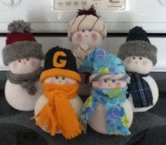 Sock Snow People. Too cute.I have a few made by a fabulous lady in Granite City,IL. =D  So easy,just do it.
