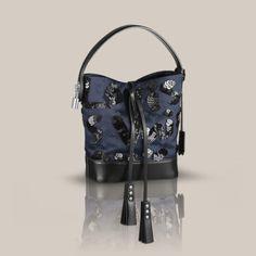 NN 14 PM Spotlight a través de Louis Vuitton