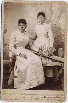 Full length double portrait, two young Black American women in identical dresses.