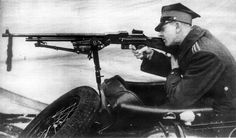 Polish soldier with a Browning wz. 28 automatic rifle on the sidecar of a Sokól 1000 motorcycle 1930s.