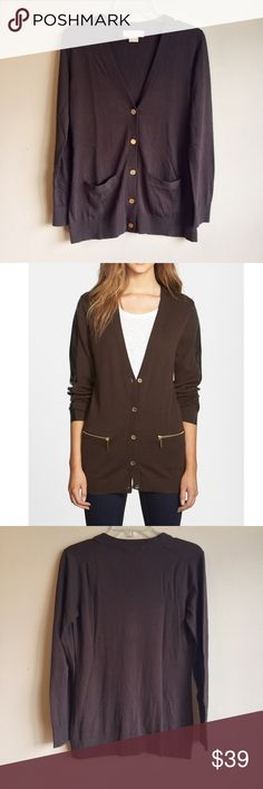 $198 PS Michael Kors Pocket Detail Cardigan V-Neck Like NEW   Gleaming gold hardware and subtle front pockets make a sophisticated and edgy update for a classic V-neck cardigan knit from a polished chocolate stretch cotton. NOTE: Model is for fit reference only with alternate hardware. •           Front button closure. •           Front zip pockets. •           56% cotton, 37% rayon,  Michael Kors SP Size Chart Bust: 33-34 Waist: 24.5-25.5 Hip: 35.5-36.5   Garment Measurements: Bust: 37…