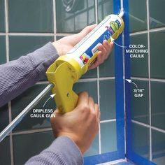 Tape before caulking your bathroom tile. It's the best way to get a clean line. Get tips: http://www.familyhandyman.compainting/tips/tips-for-caulking