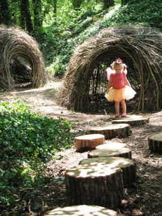 Secret  play houses created  with  twigs  and fun play with tree trunks stepping stones