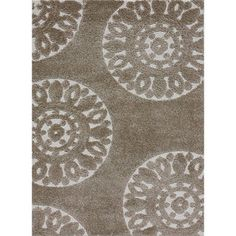 Our rug :) love it @Overstock - This stylish beige shag rug improves the overall appeal of any home. It features varying pile heights and an ivory abstract design for added style and texture. Crafted with polypropylene in a powerloomed construction, it is built for long-lasting use.http://www.overstock.com/Home-Garden/Jullian-Beige-Shag-Rug-77-x-106/5106494/product.html?CID=214117 $258.29