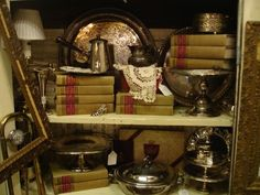 Obviously a store display, but remove the excess clutter and I like the silver and books on display