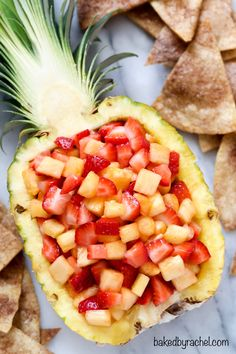 Strawberry pineapple salsa with cinnamon tortilla chips. Recipe from @Rachel {Baked by Rachel} A family friendly snack or appetizer!