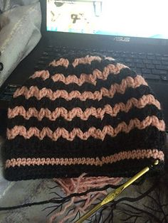 Messy Bun/Pony Tail hats are all the rage! This easy pattern whips up in no time. Use 2 colors or more! Change colors for each round to make a rainbow hat. FREE crochet pattern.