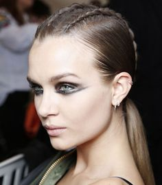Hair was braided into a trio of cornrows, tied into a low ponytail and straightened through the length at the Balmain show #PFW17 #PFW #Hair