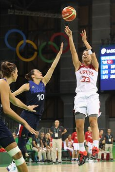#RIO2016 Best of Day 1 - Sebnem Nezahat Kimyacioglu of Turkey attempts a three point shot over Sarah Michel of France during a Women's Basketball Preliminary Round game on...