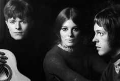 Left to right: David Bowie, Hermione Farthingale, John Hutchinson, 1968.  David had just had a severe hair-cut for what turned out to be a 2 second appearance in the film The Virgin Soldiers.