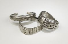 9thC-10thC, Viking. Silver armlet with overlapping ends and expanded centre with 6-pointed star of punched zigzags, a saltire on each terminal.