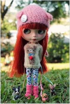 I would love to have her and her doggies! The sweater is too cute. Love that color hair too!