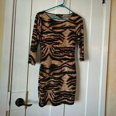 Forever 21 dress Soft stretchy dress from forever 21. Tiger stripes :). 3/4 sleeve figure hugging. Forever 21 Dresses Mini