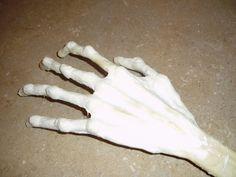 An amazingly simple skeletal hand tutorial--uses wire and old pens or coaxial cable, masking tape, and latex or paper mache. Done Halloween '13, built out a bit more, to be the Thing to my Wednesday.