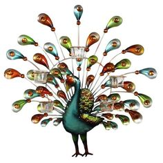 Multicolor metal wall decor with a peacock silhouette and five votive holders.  Product: Wall décorConstruction Material...