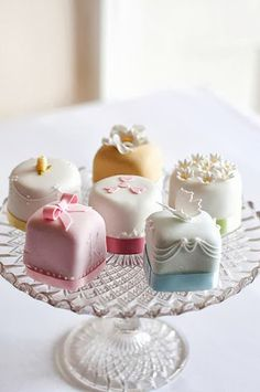 OP: Little many cakes, cover the wooden table. Dainty and bright, welcoming and special. These little cakes although do have a a secret to them. The cakes make you shrink. Every cake decorated with a different design, to show great variety that the tea party has to offer. Each little wonder, with every hidden desire.