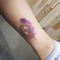Sun and moon ornamental and watercolor style tattoo on the left leg. Tattoo artist: Doy