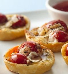 Need a tasty appetizer? Simple tomatoes, cheese and flaky pastry make a stunning nibble and addictive appetizer.