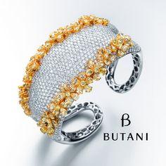 Some trends remain unchanged like a full diamond cuff with flower trimmings in fancy intense yellow diamonds #Butani #ButaniJewellery #diamonds