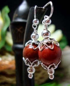 These handmade carnelian gemstone and sterling silver pierced earrings are not only gorgeous, but are said to have some great benefits to the gemstones.  The dark red orange color is striking and I