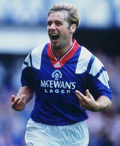 Ally McCoist celebrates scoring for Rangers in 1992.