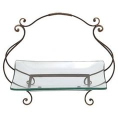 """Showcasing a scrolling metal stand and beveled glass dish, this elegant platter is perfect for displaying decorative orbs or seasonal fruits.  Product: PlatterConstruction Material: Metal and glassColor: Clear and brassFeatures:  Scrolling standBeveled dishDimensions: 17"""" H x 20"""" W x 6"""" D"""